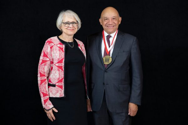 award winner on stage with medal